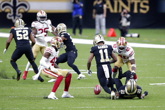 New Orleans Saints wide receiver Deonte Harris (11) fumbles a muffed punt that the San Francisco 49ers recovered in the first half of an NFL football game in New Orleans, Sunday, Nov. 15, 2020. (AP Photo/Butch Dill)