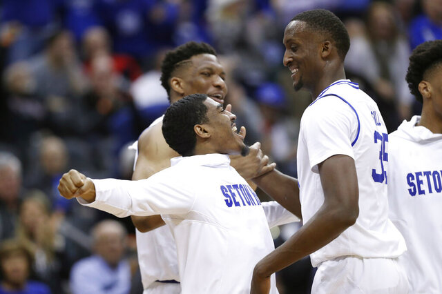 Seton Hall center Romaro Gill (35) ceclebrate with teammates after dunking against two Maryland defenders during the first half of an NCAA college basketball game, Thursday, Dec. 19, 2019, in Newark, N.J. (AP Photo/Kathy Willens)
