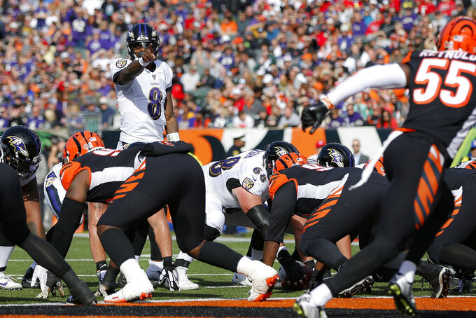 Baltimore Ravens quarterback Lamar Jackson (8) calls a play during the first half of NFL football game against the Cincinnati Bengals, Sunday, Nov. 10, 2019, in Cincinnati. (AP Photo/Frank Victores)