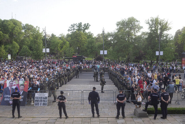 Serbian police officers separate populist government supporters, left, from the opposition followers, right, amid heightened political tensions ahead of next month's parliamentary election, in Belgrade, Serbia, Monday, May 11, 2020. The two rallies were held outside the parliament building where politicians from both camps have said they were staging a hunger strike. (AP Photo/Marko Drobnjakovic)