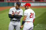 Detroit Tigers' Joe Jimenez, left, talkes with St. Louis Cardinals' Yadier Molina prior to the start of the first game of a baseball doubleheader Thursday, Sept. 10, 2020, in St. Louis. Both players are wearing the number 21 in honor of Roberto Clemente. (AP Photo/Scott Kane)