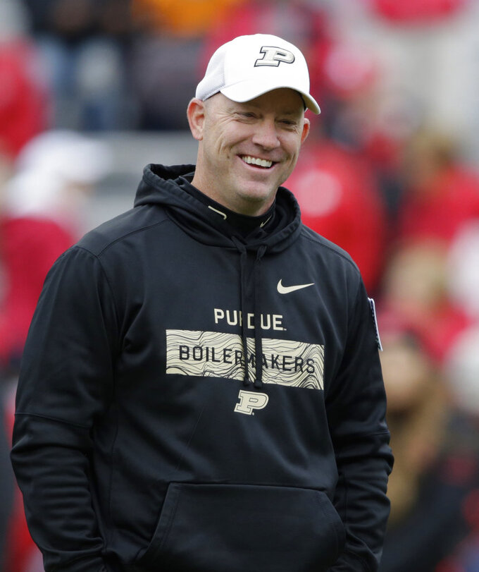 FILE - In this Sept. 29, 2018, file photo, Purdue head coach Jeff Brohm smiles on the field before an NCAA college football game against Nebraska, in Lincoln, Neb. Indiana coach Tom Allen and  Brohm understand the short-term stakes of Saturday's Old Oaken Bucket game. The winner plays another game this season while the loser heads home to start offseason work, just like last year. Just like it seems every year.  (AP Photo/Nati Harnik, FIle)