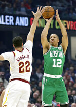 Boston Celtics' Grant Williams (12) shoots over Cleveland Cavaliers' Larry Nance Jr. (22) in the first half of an NBA basketball game, Tuesday, Nov. 5, 2019, in Cleveland. (AP Photo/Tony Dejak)
