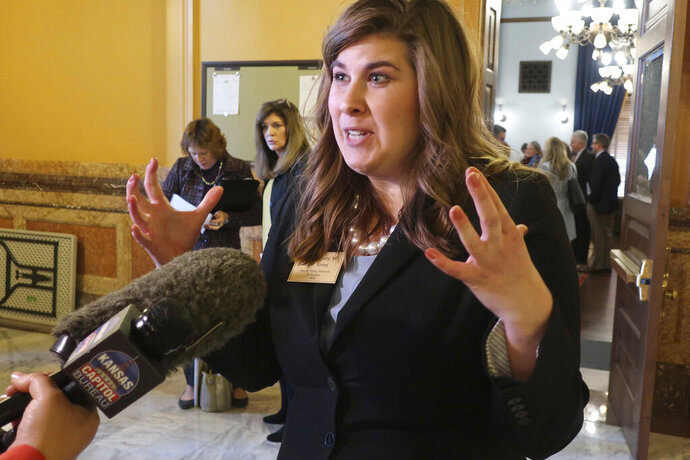 Brittany Jones, advocacy director for the conservative Family Policy Alliance of Kansas, answers questions from reporters following the unveiling of a proposed amendment to the Kansas Constitution on abortion, Thursday, Jan. 16, 2020 at the Statehouse in Topeka, Kansas. Jones' group and other anti-abortion organizations are backing the amendment, which would overturn a Kansas Supreme Court decision protecting abortion rights. (AP Photo/John Hanna)