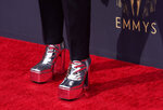 Bowen Yang arrives at the 73rd Primetime Emmy Awards on Sunday, Sept. 19, 2021, at L.A. Live in Los Angeles. (AP Photo/Chris Pizzello)