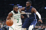 Boston Celtics guard Jaylen Brown (7) drives to the basket against Dallas Mavericks guard Tim Hardaway Jr. (11) during the first quarter of an NBA basketball game in Boston, Monday, Nov. 11, 2019. (AP Photo/Charles Krupa)