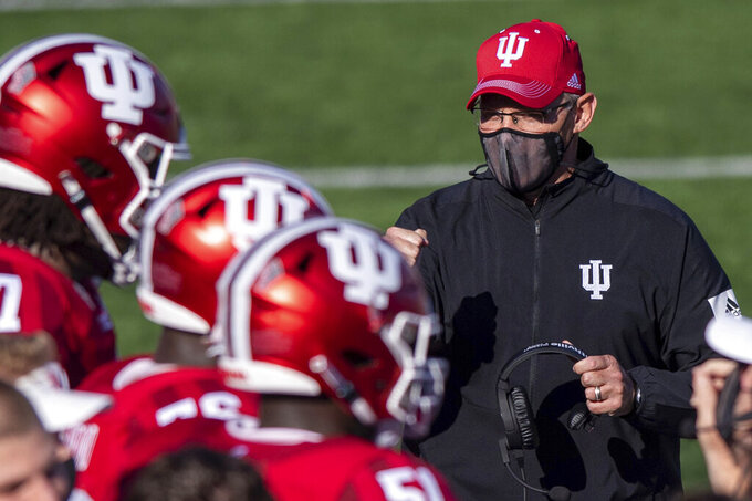 FILE - In this Saturday, Nov. 7, 2020, file photo, Indiana head coach Tom Allen looks towards his players on the sideline during a break in the second half of an NCAA college football game against Michigan in Bloomington, Ind. In an era when the College Football Playoff increasingly features the nation's highest-scoring teams, this year's Big Ten race shows defense still matters. (AP Photo/Doug McSchooler, File)