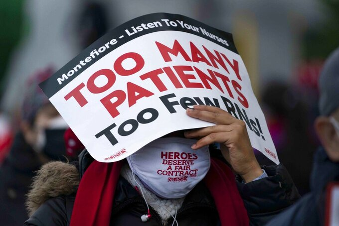 FILE - This photo from Tuesday Dec. 1, 2020, shows a nurse during a protest strike over safe staffing issues at Montefiore Hospital in New Rochelle, N.Y. Gov. Andrew Cuomo has signed legislation, Friday, June 18, 2021, requiring general hospitals in the state to seek input from nurses and other staff in creating staffing plans that are to include specific guidelines on how many patients each nurse is assigned. (AP Photo/Mark Lennihan)