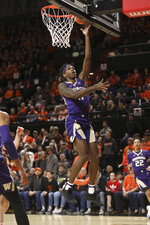 Washington's Nahziah Carter drives to the basket during the first half of an NCAA college basketball game against Oregon State in Corvallis, Ore., Saturday, Jan. 26, 2019. (AP Photo/Amanda Loman)