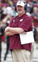FILE - In this April 13, 2019, file photo, Mississippi State football coach Joe Moorhead observes his team's spring NCAA college football game in Starkville, Miss. The main story of Mississippi State's preseason camp isn't hard to find. It's a two-man quarterback competition between last year's backup Keytaon Thompson and Penn State transfer Tommy Stevens. The winner will be expected to improve the Bulldogs' passing offense, which was inconsistent on good days and downright awful on the bad ones last season. (AP Photo/Rogelio V. Solis, File)