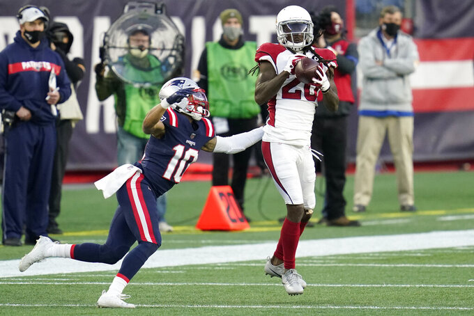 Arizona Cardinals cornerback Dre Kirkpatrick, right, intercepts a pass intended for New England Patriots wide receiver Damiere Byrd, left, in the second half of an NFL football game, Sunday, Nov. 29, 2020, in Foxborough, Mass. (AP Photo/Charles Krupa)