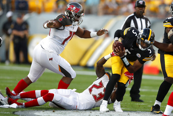 Pittsburgh Steelers quarterback Joshua Dobbs (5) is sacked by Tampa Bay Buccaneers outside linebacker Deone Bucannon (23) during the first half of an NFL preseason football game in Pittsburgh, Friday, Aug. 9, 2019. (AP Photo/Keith Srakocic)