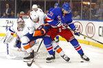 New York Islanders defenseman Ryan Pulock (6) defends New York Rangers center Brett Howden (21) in front of Islanders goaltender Semyon Varlamov (40) during the second period of an NHL hockey game, Monday, Jan. 13, 2020, in New York. (AP Photo/Kathy Willens)