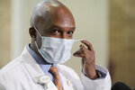 Dr. Leon Haley Jr. the CEO of UF Health Jacksonville removes his mask to talk with the media shortly before he received the first injection of the COVID-19 vaccine, Monday, Dec. 14, 2020, in Jacksonville, Fla. Haley, 56, who was lauded for his efforts in response to COVID-19, died in an accident involving a personal watercraft vehicle, officials said. Haley was ejected from a personal watercraft in Palm Beach Inlet on Saturday, July 24, 2021, the Florida Fish and Wildlife Conservation Commission said. (Bob Self/The Florida Times-Union via AP)