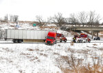 Traffic was rerouted on the eastbound lane of Interstate 80 near Adel, Iowa, after a semi truck jackknifed and took up both lanes of the freeway on Friday, Jan. 17, 2020. The accident was related to a winter storm, which dumped several inches of snow across much of central and northern Iowa. (Bryon Houlgrave/The Des Moines Register via AP)