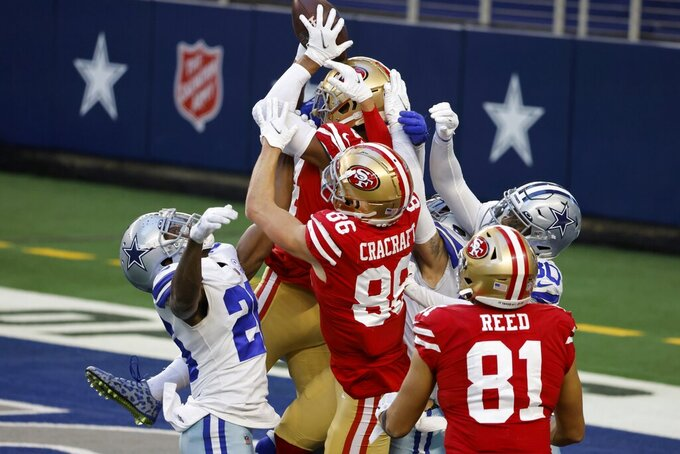San Francisco 49ers wide receiver Kendrick Bourne (84) leaps upward to catch a Hail Mary pass in the end zone for a touchdown in the second half of an NFL football game against the Dallas Cowboys in Arlington, Texas, Sunday, Dec. 20, 2020. (AP Photo/Ron Jenkins)