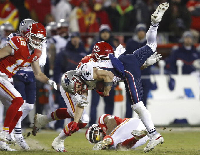New England Patriots wide receiver Julian Edelman (11) is tackled by Kansas City Chiefs linebacker Frank Zombo (51) during the second half of the AFC Championship NFL football game, Sunday, Jan. 20, 2019, in Kansas City, Mo. (AP Photo/Charlie Neibergall)