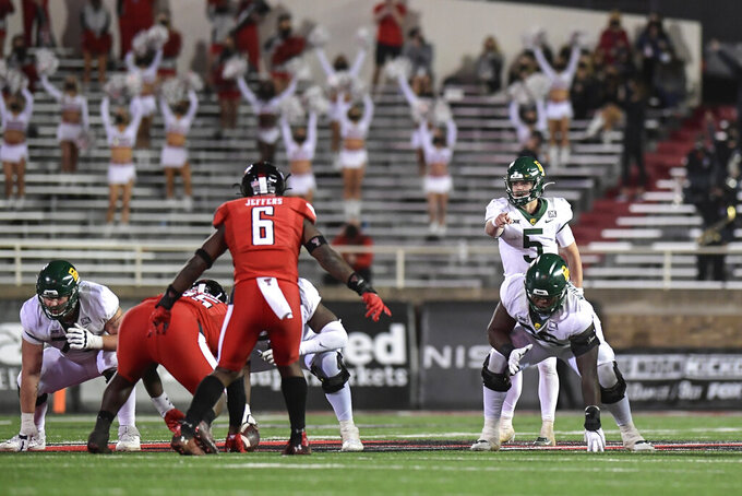 Baylor quarterback Charlie Brewer (5) calls a play against Texas Tech during the second half of an NCAA college football game in Lubbock, Texas, Saturday, Nov. 14, 2020. (AP Photo/Justin Rex)