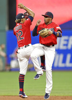 Cleveland Indians' Francisco Lindor, left, and Greg Allen celebrate after the Indians defeated the Kansas City Royals 10-5 in a baseball game Friday, July 19, 2019, in Cleveland. (AP Photo/Tony Dejak)
