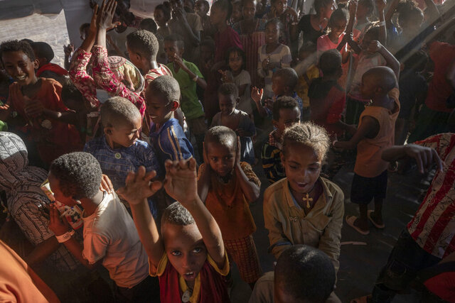Tigray refugee children sing and dance inside a tent run by UNICEF for children's activities, in Umm Rakouba refugee camp in Qadarif, eastern Sudan, Thursday, Dec. 10, 2020. (AP Photo/Nariman El-Mofty)