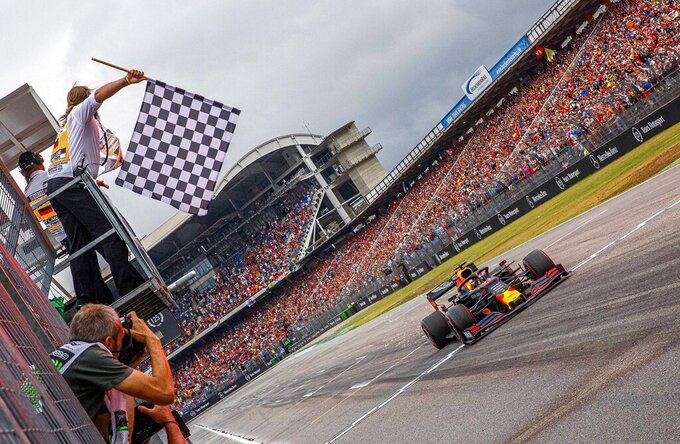 Red Bull driver Max Verstappen of the Netherland's crosses the finish line to win the German Formula One Grand Prix at the Hockenheimring racetrack in Hockenheim, Germany, Sunday, July 28, 2019. (Epa pool photo Via AP/Suki Sulejmanovic)