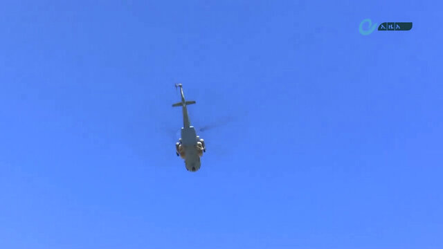 This image made from undated video released by the state-owned Ethiopian News Agency on Monday, Nov. 16, 2020 shows a helicopter in the sky over an area near the border of the Tigray and Amhara regions of Ethiopia. Ethiopia's prime minister Abiy Ahmed said in a social media post on Tuesday, Nov. 17, 2020 that