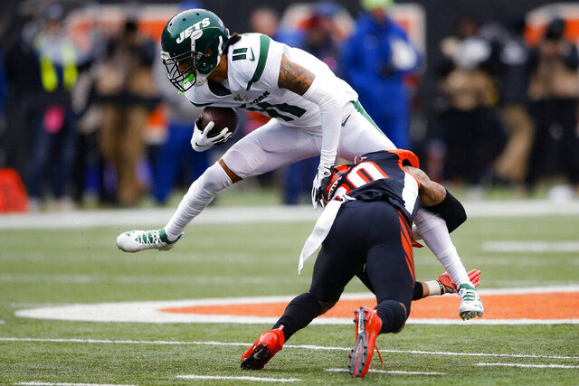 New York Jets wide receiver Robby Anderson (11) is tackled by Cincinnati Bengals free safety Jessie Bates (30) during the second half of an NFL football game, Sunday, Dec. 1, 2019, in Cincinnati. (AP Photo/Gary Landers)