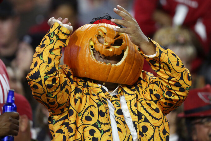 A fan dressed in a halloween costume cheers during the second half of an NFL football game between the San Francisco 49ers and the Arizona Cardinals, Thursday, Oct. 31, 2019, in Glendale, Ariz. (AP Photo/Ross D. Franklin)