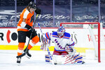 New York Rangers' Igor Shesterkin, right, blocks a shot past Philadelphia Flyers' Nolan Patrick during the second period of an NHL hockey game, Thursday, March 25, 2021, in Philadelphia. (AP Photo/Matt Slocum)