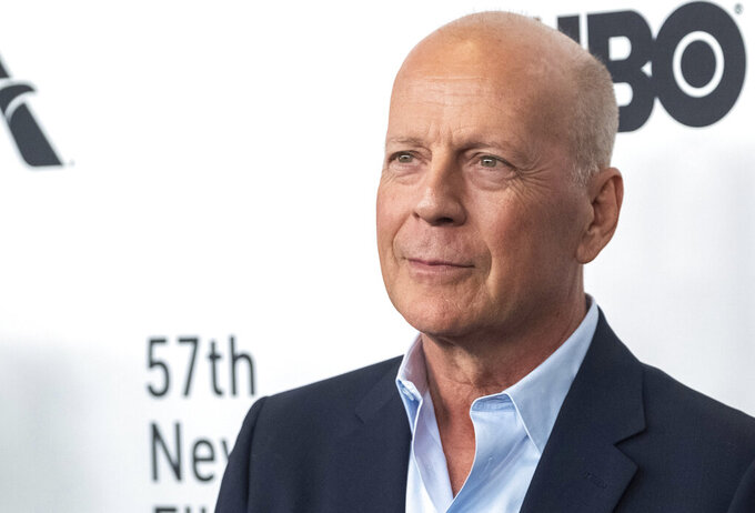 """FILE - In this Friday, Oct. 11, 2019, file photo, Bruce Willis attends the """"Motherless Brooklyn"""" premiere during the 57th New York Film Festival at Alice Tully Hall, in New York. People in Mississippi's capital city are being told to expect downtown street closures and explosions for the filming of an action movie that stars Willis. A bank heist movie called """"A Day to Die"""" has been filming in Jackson in April 2021, with Willis shooting scenes in several places, including a street outside the Governor's Mansion. (Photo by Charles Sykes/Invision/AP, File)"""