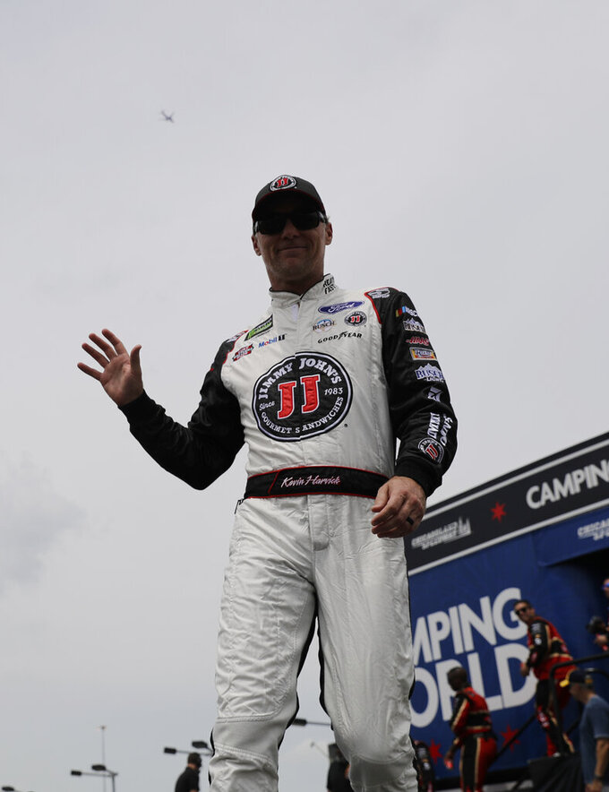 Kevin Harvick waves to the crowd during drivers introduction before the NASCAR Cup Series auto race at Chicagoland Speedway in Joliet, Ill., Sunday, June 30, 2019. (AP Photo/Nam Y. Huh)