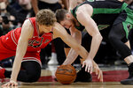 Chicago Bulls forward Lauri Markkanen, left, and Boston Celtics forward Gordon Hayward compete for the ball during the first half of an NBA basketball game in Chicago, Saturday, Jan. 4, 2020. (AP Photo/Nam Y. Huh)