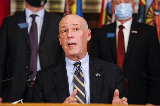 Montana Gov. Greg Gianforte speaks with the press on Wednesday, Feb. 10, 2021 in the State Capitol in Helena, Mont. Gianforte said he would lift a statewide mask requirement later this week after he signed a bill that is intended to protect businesses and health care providers from coronavirus-related lawsuits. (Thom Bridge/Independent Record via AP)