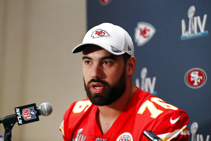 FILE - In this Wednesday, Jan. 29, 2020, file photo, Kansas City Chiefs offensive guard Laurent Duvernay-Tardif (76) speaks during a news conference in Aventura, Fla., for the NFL Super Bowl 54 football game. Duvernay-Tardif, of the Super Bowl champion Kansas City Chiefs, became the first player to opt out of the upcoming NFL season due to the coronavirus pandemic, Friday, July 24, 2020. (AP Photo/Brynn Anderson, File)