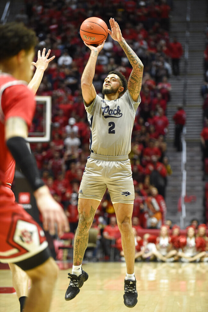 Nevada guard Jalen Harris (2) shoots during the first half of an NCAA college basketball game against San Diego State, Saturday, Jan. 18, 2020, in San Diego. (AP Photo/Denis Poroy)