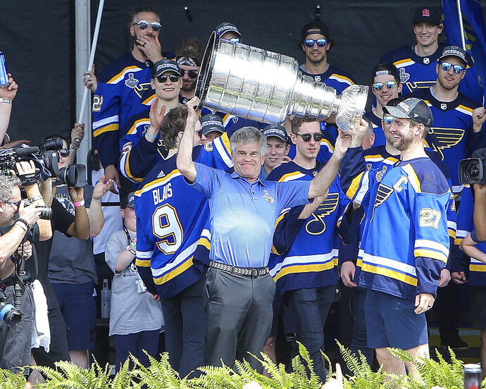 St. Louis Blues Chairman and Governor Tom Stillman holds the Stanley Cup overhead during the NHL hockey Stanley Cup victory celebration in St. Louis on Saturday, June 15, 2019. (AP Photo/Scott Kane)