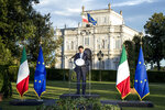 Italian Premier Giuseppe Conte meets the media after a meeting of Italian economists, members of the government and top industrialists in the historical Villa Pamphili, to discuss ideas to relaunch economy after COVID-1 pandemic, in Rome Sunday, June 21, 2020. (Roberto Monaldo/LaPresse via AP)