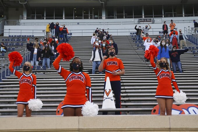 For the first time in the 2020 season Virginia cheerleaders attended a game in person Saturday, Nov. 14, 2020 at Scott Stadium in Charlottesville. (Erin Edgerton/The Daily Progress via AP)