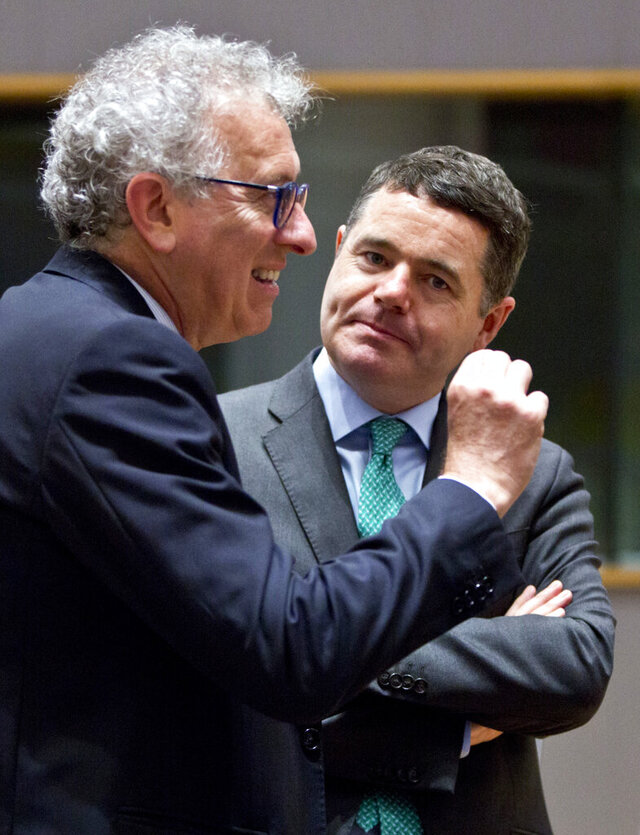 FILE - In this Friday, May 25, 2018 file photo, Luxembourg's Finance Minister Pierre Gramegna, left, speaks with Irish Finance Minister Paschal Donohoe during a meeting of EU finance ministers at the Europa building in Brussels. The powerful group of countries using Europe's single currency will choose a new president on Thursday, July 9, 2020, with three candidates vying for the challenging task of leading the 19-nation bloc out of the deepest economic recession in decades. The candidates for Eurogroup president are Spain's Economy Minister Nadia Calvino, Irish Finance Minister Paschal Donohoe and Luxembourg's Finance Minister Pierre Gramegna. (AP Photo/Virginia Mayo, File)