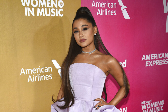"FILE - In this Dec. 6, 2018, file photo, Ariana Grande attends the 13th annual Billboard Women in Music event at Pier 36 in New York. Grande is telling her fans that she has a bad sinus condition that has made her ""very sick"" and might force her to cancel upcoming shows on her world tour. Grande, 26, says in videos posted on Instagram Saturday, Nov. 16, 2019, that ""my throat and head are still in so much pain."" (Photo by Evan Agostini/Invision/AP, File)"
