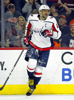 Washington Capitals' Alex Ovechkin skates back to the bench after assisting on the goal by Tom Wilson during the first period of an NHL hockey game against the Philadelphia Flyers Wednesday, March 6, 2019, in Philadelphia. (AP Photo/Tom Mihalek)