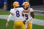Pittsburgh wide receiver DJ Turner (9) is greeted by quarterback Kenny Pickett (8) after scoring a touchdown against Austin Peay during the first half of an NCAA college football game, Saturday, Sept. 12, 2020, in Pittsburgh. (AP Photo/Keith Srakocic)