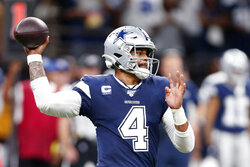 Dallas Cowboys quarterback Dak Prescott (4) passes in the first half of an NFL football game against the New Orleans Saints in New Orleans, Sunday, Sept. 29, 2019. (AP Photo/Gerald Herbert)