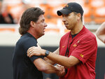 Oklahoma State head coach Mike Gundy, left, shakes hands with Iowa State head coach Matt Campbell, right, before an NCAA college football game in Stillwater, Okla., Saturday, Oct. 6, 2018. (AP Photo/Sue Ogrocki)