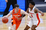 Syracuse guard Joseph Girard III (11) drives on Houston guard Marcus Sasser (0) in the second half of a Sweet 16 game in the NCAA men's college basketball tournament at Hinkle Fieldhouse in Indianapolis, Saturday, March 27, 2021. (AP Photo/AJ Mast)