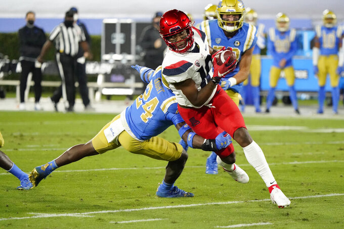 Arizona wide receiver Jamarye Joiner (10) runs after a catch during the first half of the team's NCAA college football game against UCLA on Saturday, Nov. 28, 2020, in Pasadena, Calif. (AP Photo/Marcio Jose Sanchez)