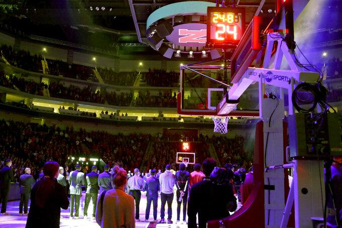 Nebraska and Michigan note the passing of Kobe Bryant before an NCAA college basketball game in Lincoln, Neb., Tuesday, Jan. 28, 2020. (AP Photo/Nati Harnik)