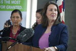 U.S. Rep Diana DeGette, D-Colo., front makes a point as Interior Secretary Deb Haaland looks on during a news conference after Haaland's visit to talk about federal solutions to ease the effects of the drought at the offices of Denver Water, Thursday, July 22, 2021, in Denver. Haaland will make stops in two cities on Colorado's Western Slope as part of her trip to assess the effects of the drought on the Centennial State. (AP Photo/David Zalubowski)