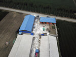 In this May 8, 2019, aerial photo, white disinfectant powder is sprinkled on the soil around a pig farm owned by farmer Yang Wenguo in Jiangjiaqiao village in northern China's Hebei Province. Pork lovers worldwide are wincing at prices that have jumped by up to 40 percent as China's struggle to stamp out African swine fever in its vast pig herds sends shockwaves through global meat markets. (AP Photo/Sam McNeil)