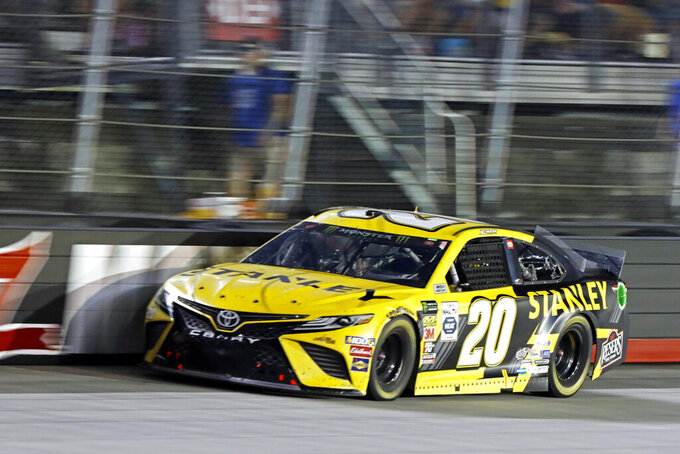 Erik Jones (20) goes down the back straight during a NASCAR Cup Series auto race, Saturday, Aug. 17, 2019, in Bristol, Tenn. (AP Photo/Wade Payne)